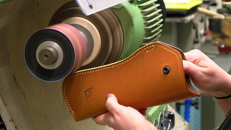 A leather holster being finished: RADAR has been manufacturing pistol holsters ever since the 1970s