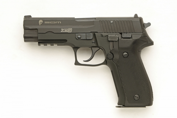 Left side view of the S.D.M. XM9 Tactical semi-automatic pistol