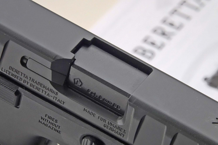 "The ejection port sports the ""F-in-pentagon"", a German proof stamp for airguns and airsoft replicas"
