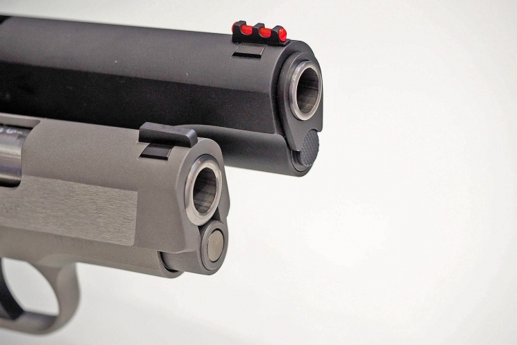 A comparison of the muzzle and recoil spring front plug on the Colt Defender and Colt Competition pistols