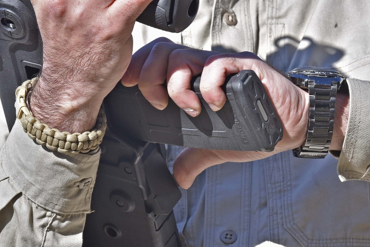 The slide stop catch is located right behind the magazine well, just in the right position to be activated with the shooter's thumb when inserting the magazine, but there are downsides with that too
