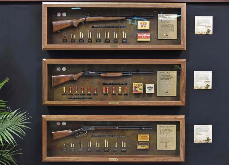 From The Cody Museum: a Winchester model 70, a Model 12 shotgun, and a Winchester model 1894 rifle