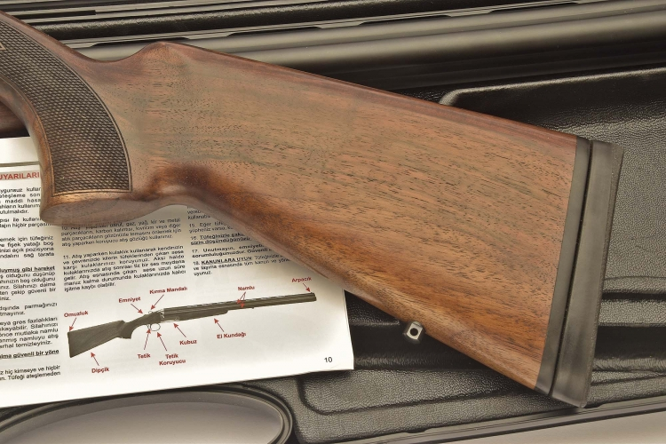 The stock, with the pistol grip