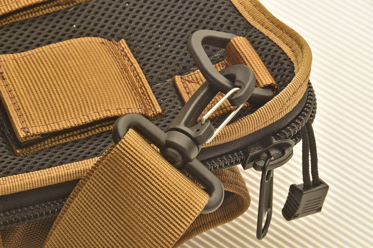 A close-up of the snap-hook that holds the shoulder sling in place