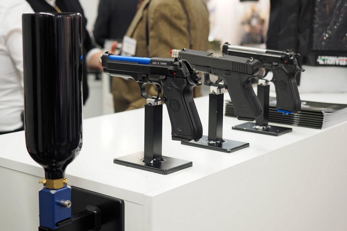 Three pistols fitted with the laser emitters of the ACP training system