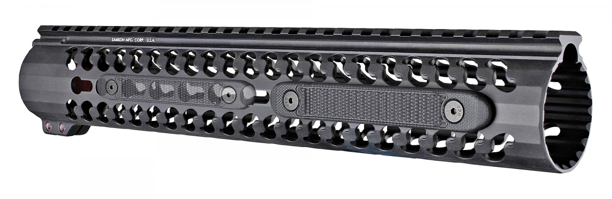 The new Hogue G10 KeyMod rail covers mounted, with another one (ghosted) at left