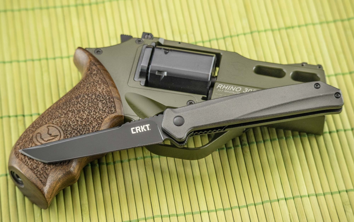 """The CRKT Helical Black folding knife, pictured with a Chiappa Firearms Rhino """"Hunter"""" revolver"""