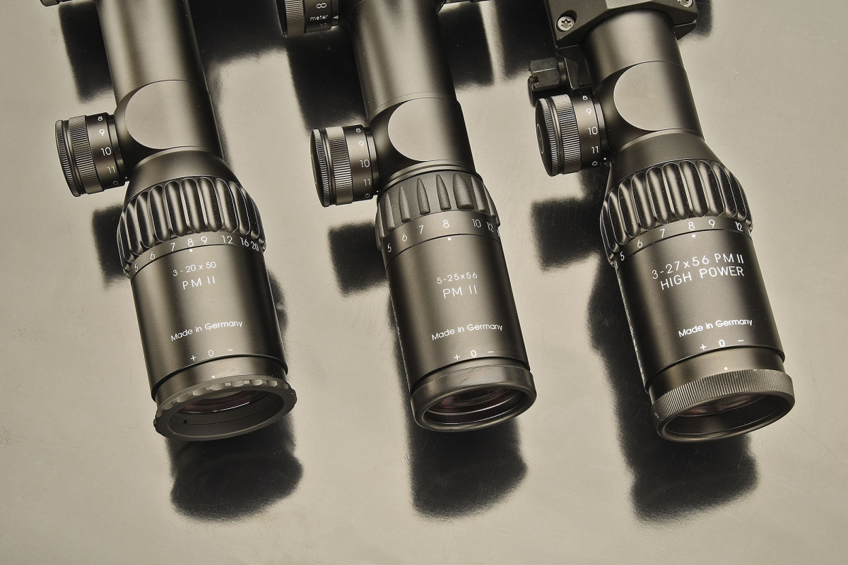 The eyepieces of the three Schmidt & Bender PM II rifle scopes, with their zoom and luminosity ratios