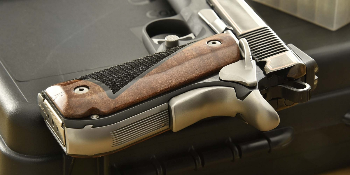 The walnut grip panels feature checkered black Micarta inserts
