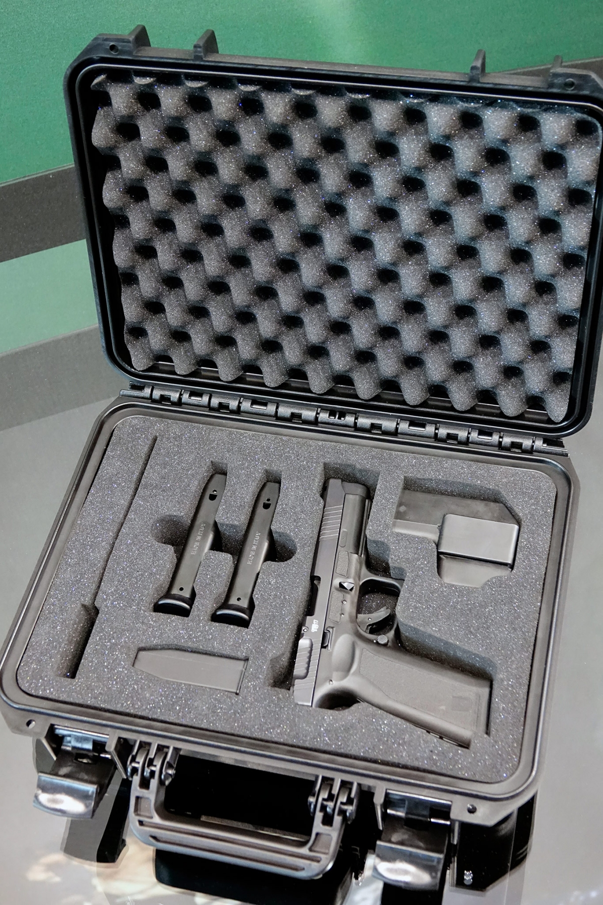 The Czech Small Arms Vz.15 pistol is sold in a foam-padded special case, jointly with two magazines, a magazine loader, a cleaning rod, and a dedicated holster