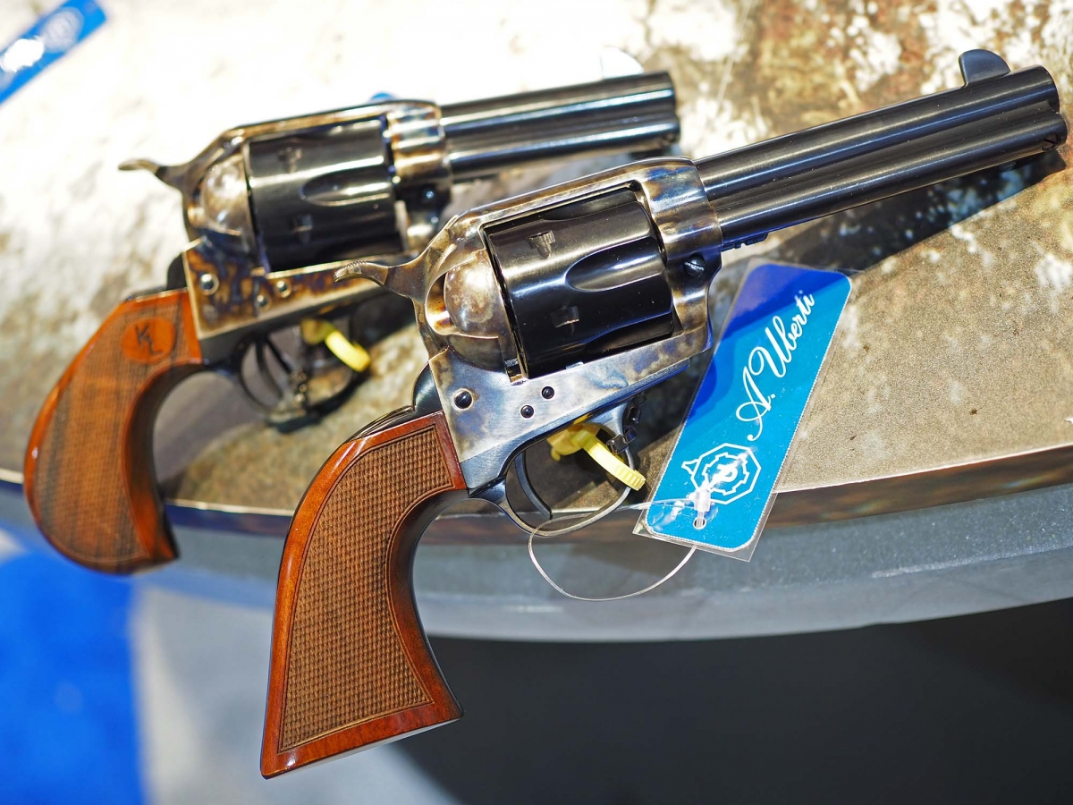 "Left to right: the Uberti 1873 Short Stroke revolver designed for Kenda Lenseigne, and a standard 4 3/4"" barrel version, as well equipped with a short stroke hammer action"