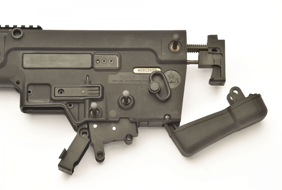 All it takes to field-strip the X95 is the removal of three passing pins: one holds the buttpad in place, the others allow the removal of the hold-open lever and the release of the trigger group