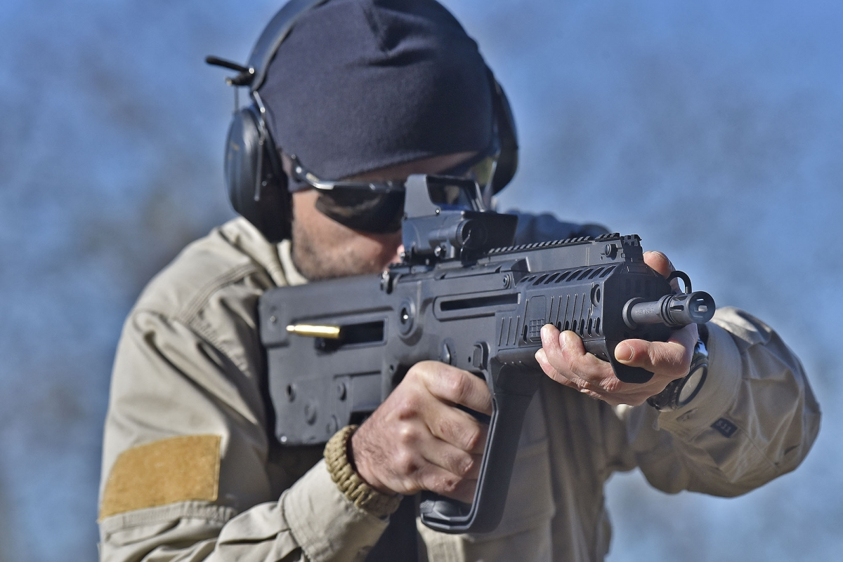 All key components in a bullpup rifle is located within the stock, and that's where spent cases come out from as wekk