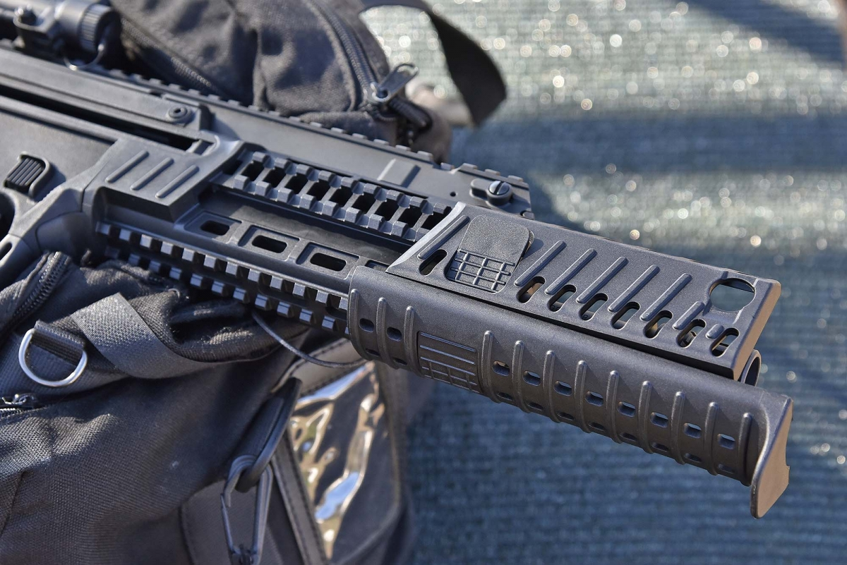 The polymer protective panels can slide out of the handguard to expose all the tactical rails, or even just one or two at the time