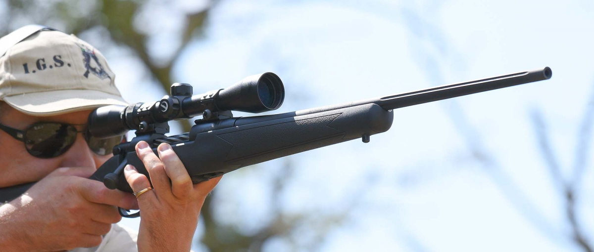 The rifle features a fluted barrel