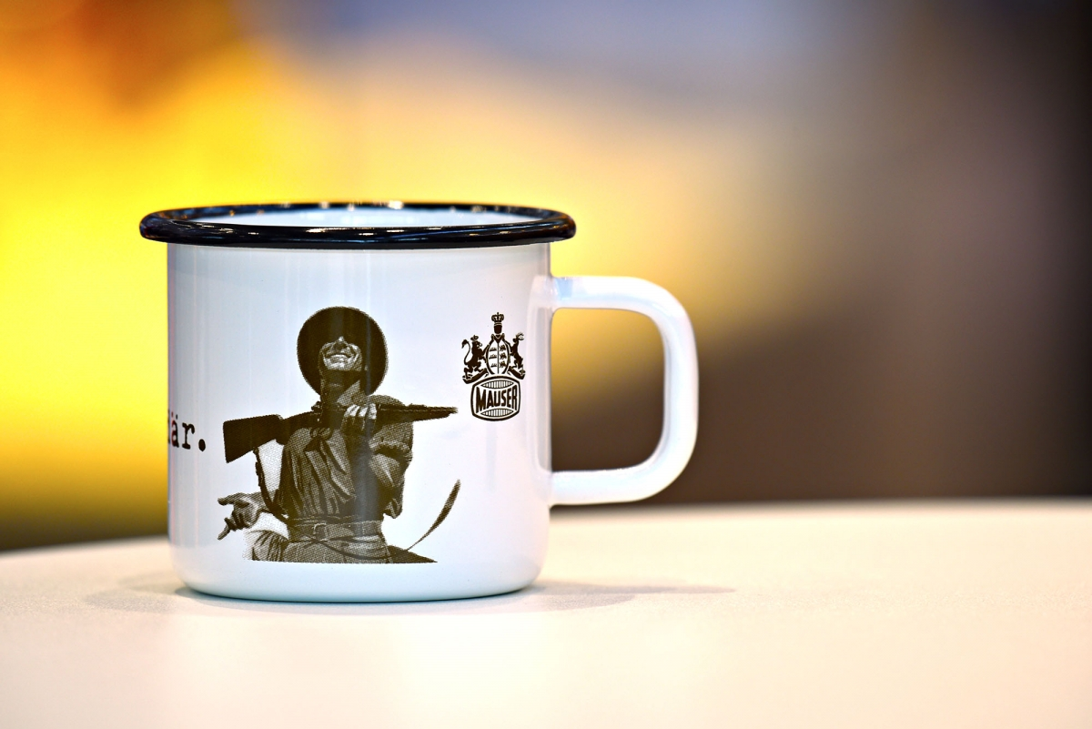 """A very traditional """"African Hunter"""" cup with the Mauser Brand logo"""