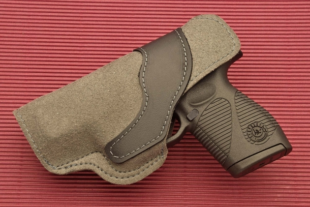 A polymer liner wraps both sides of the holster