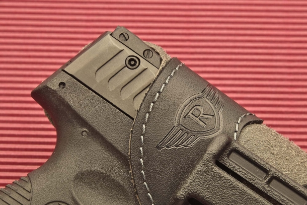 The holster mouth is reinforced with an outer polymer lining