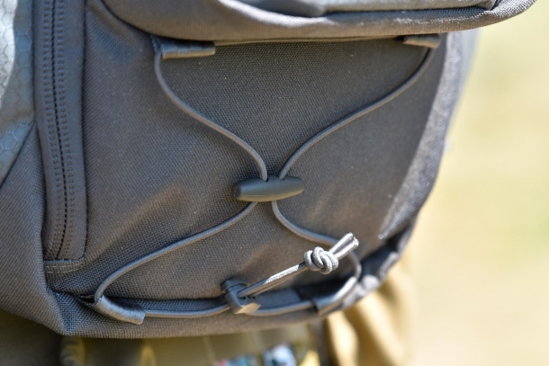 Detail of the retention cord underneath the front pocket