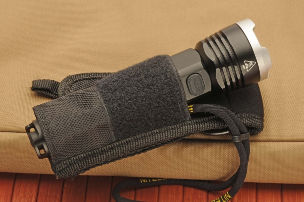 The flashlight with its belt holster