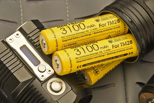 Four rechargeable batteries come with the Nitecore TM28