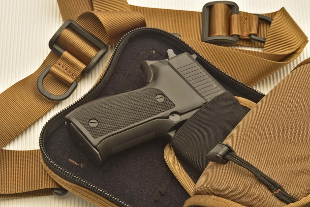 A full-size SIG Sauer P226 pistol in the internal holster