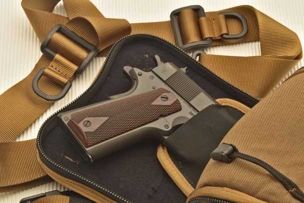 A full-size Colt M1911-A1 pistol in the internal holster