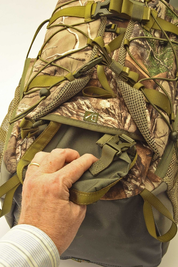 The rifle buttstock support pouch is inside the front flap