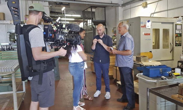 A picture from the backstage: Niccolò Campriani, Gianpiero Pardini and the Olympic Channel staff at the Pardini Armi plant in Lido di Camaiore (Italy)