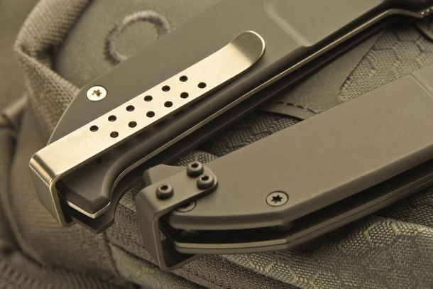 The different sides of the belt clip, installed on the grip by Allen screws