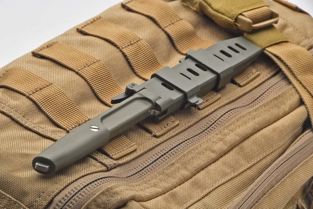 The sheath fastens to M.O.L.L.E. systems thanks to two adjustable clips