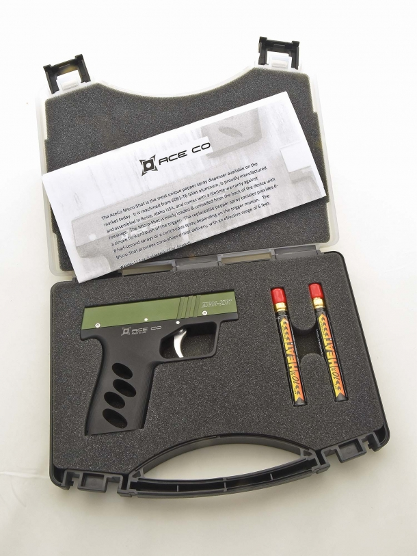 The Ace Co. Micro-Shot as sold in its case, which includes an OC canister and a training cartridge