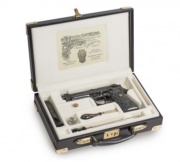 The Beretta 98FS Demon pistol in its case