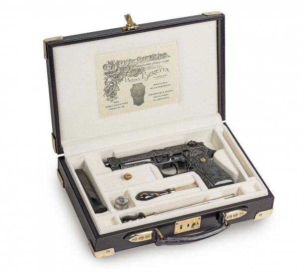 The Beretta 98FS Demon pistol in its case