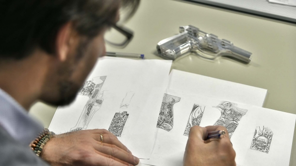 The master engraver prepares the sketches for the engravings