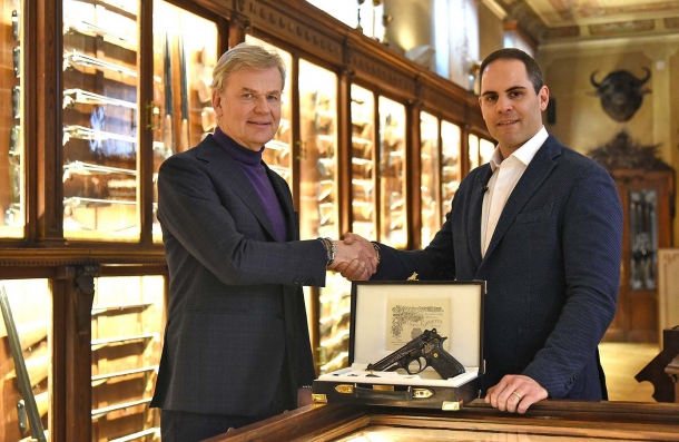 Fabiano Visintini (at right) is the person who has started the Beretta 98FS Demon project. Here, Beretta's President Franco Gussalli Beretta consigns him the pistol personally