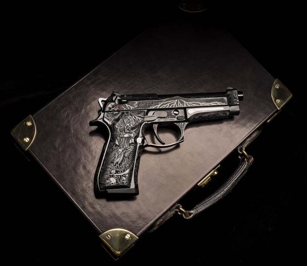 The Beretta 98FS Demon piston on its leather case