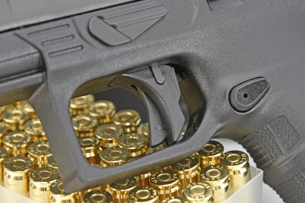 A close-up of the trigger safety on the Beretta APX Combat
