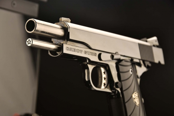 A close-up of the typical star engraved on front of the guide rod of all Cabot Guns 1911s