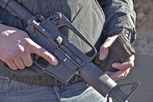 The Olympic Arms K23B Stubby feeds through STANAG 4179 compliant AR-15 magazines