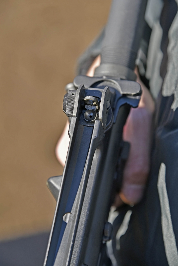 The adjustable rear sight, located on the carrying handle