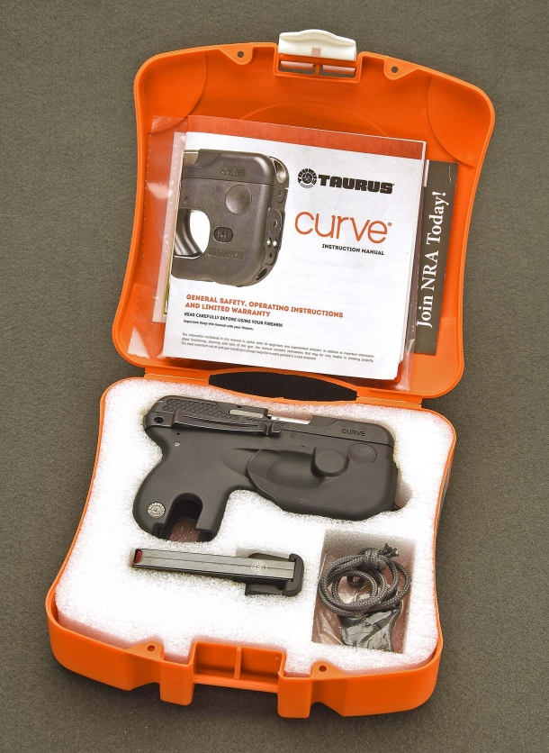 The Taurus 180 Curve pistol is sold in a bright orange box