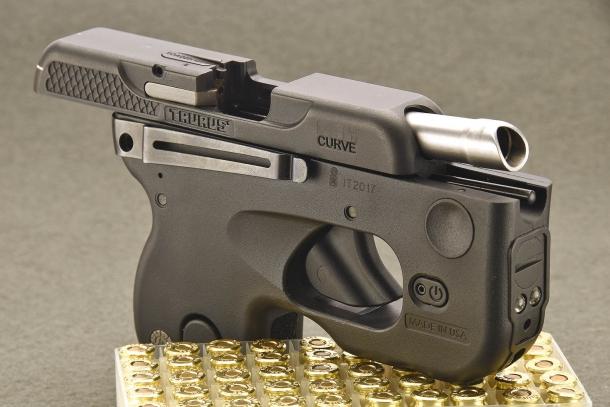 The slide of the Taurus 180 Curve pistol, held open