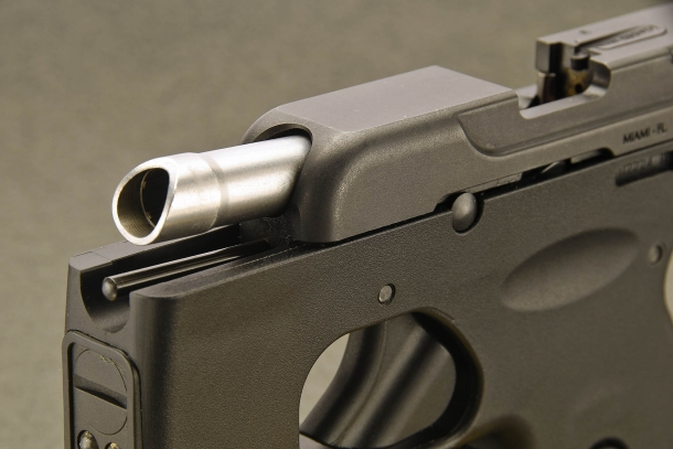 A close-up of the slant muzzle of the Taurus 180 Curve pistol