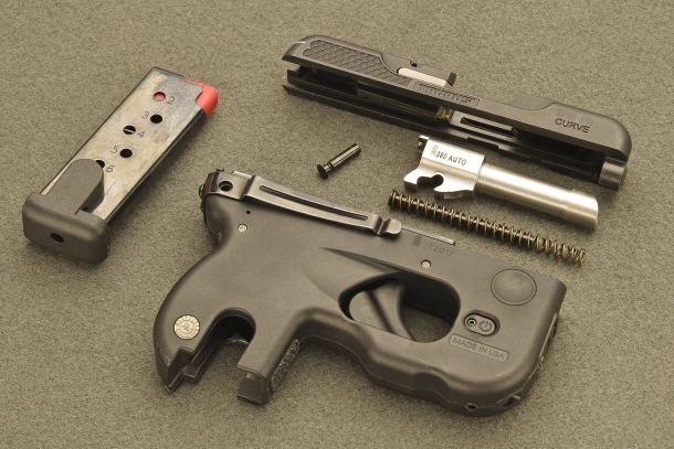 The Taurus 180 Curve pistol, field-stripped