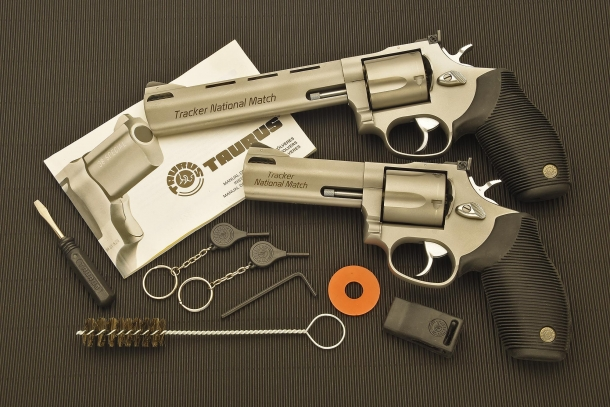 The two revolvers pictured with the factory-issued documents and accessories