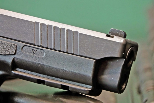 The polymer frame features a MIL-STD 1913 Picatinny rail for tactical accessories