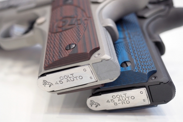 A comparison of the grips and magazine wells on the Colt Defender and Colt Competition pistols