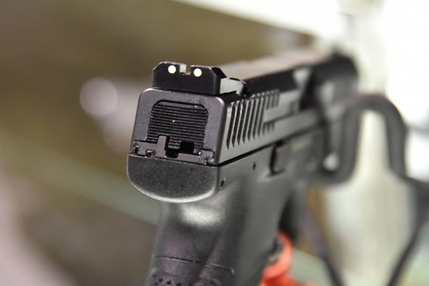 The striker-fired CZ P10C comes with three-dot dovetailed sights