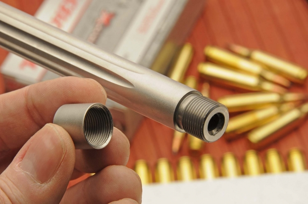 The rifle features a muzzle thread, protected by a screw-on cap, allowing the use of sound suppressors, where allowed